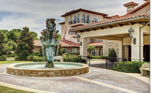 Driveway featuring large water fountain feature at Conservatory at Plano