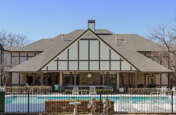 Pool area at Country Club At Woodland Hills with clear blue skies