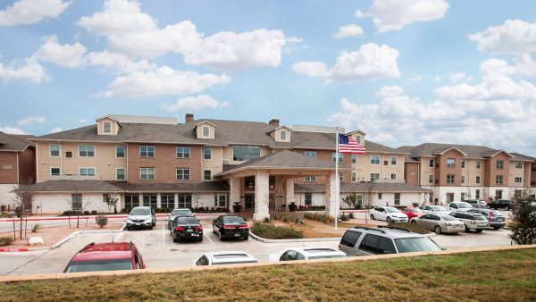Emerald Oaks Retirement main parking area including covered driveway and building entrance