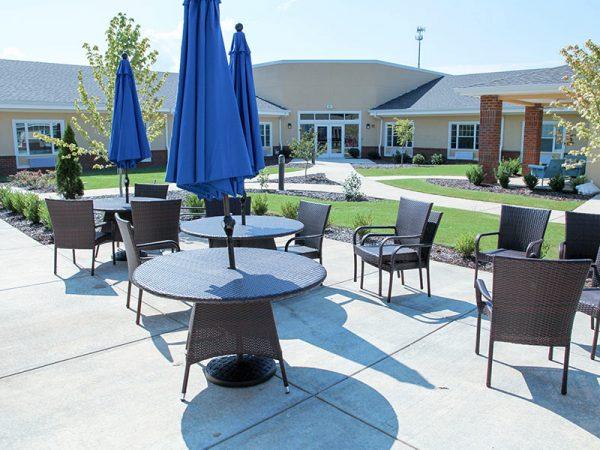 Umbrella tables and outdoor seating at Regency Retirement Village - Huntsville