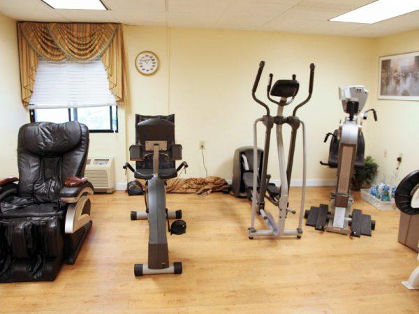Fitness center and exercise equipment in Regency Retirement Village - Huntsville
