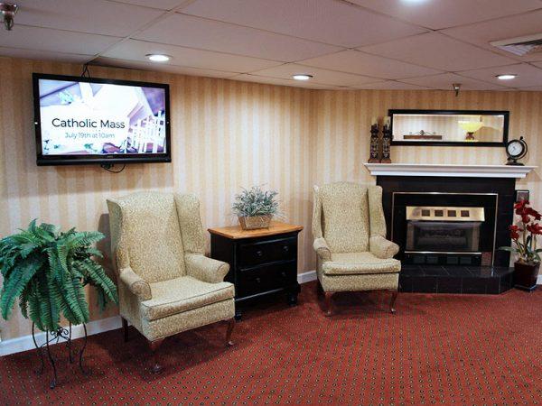 Regency Retirement Village - Huntsville community living room and fireplace