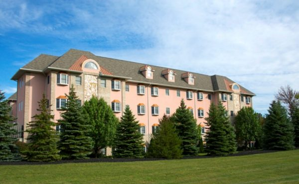 View of building with evergreen trees in front of Generations Senior Living of Strongsville
