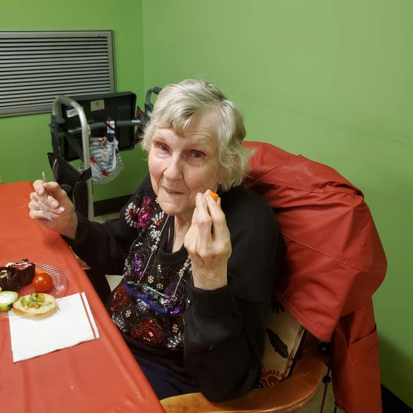 Female Jenni Lynn resident enjoying snacks
