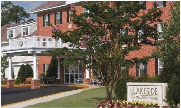 Main entrance with brick fascade and trees at Lakeside at Mallard Landing
