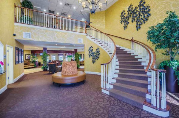 Grand curved staircase in the lobby of The Village at Southlake