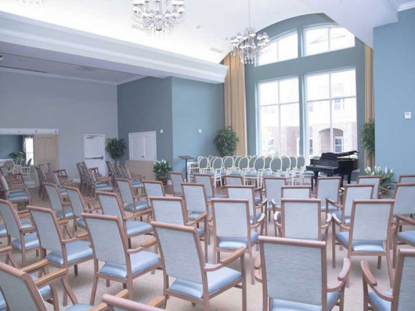 Chairs lined up in rows in the Brightmore of South Charlotte meeting room