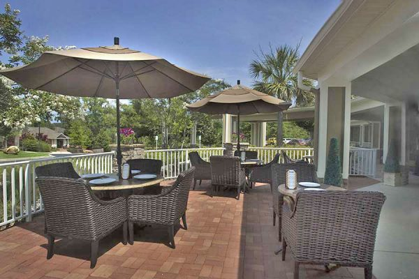 The Village at Southlake outdoor dining area with umbrella covered tables