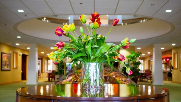 Colorful flowers in the lobby of Provident Crossings Retirement