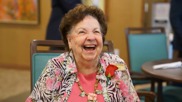 Senior female Red Rock Pointe Retirement resident laughing and smiling