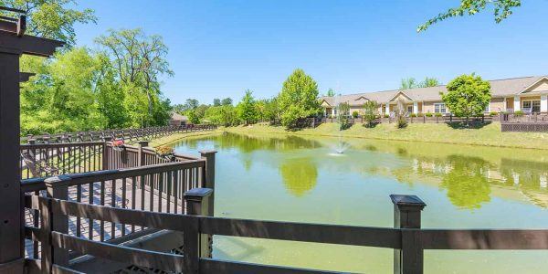 Deck with a small pond at The Village at Southlake