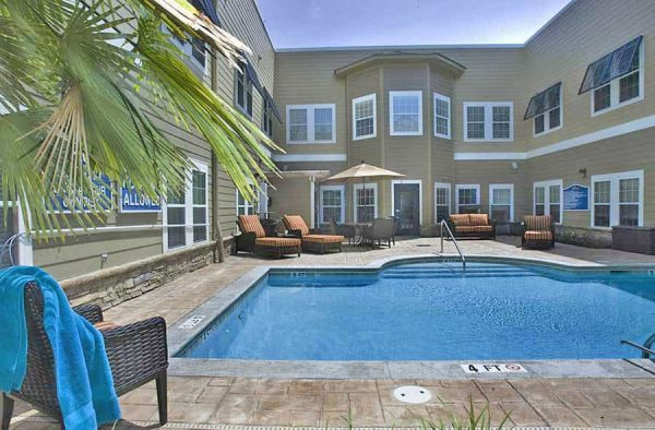 Outdoor swimming pool and lounge chairs at The Village at Southlake