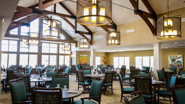 Vickery Rose Retirement community dining room with large exposed wooden trusses