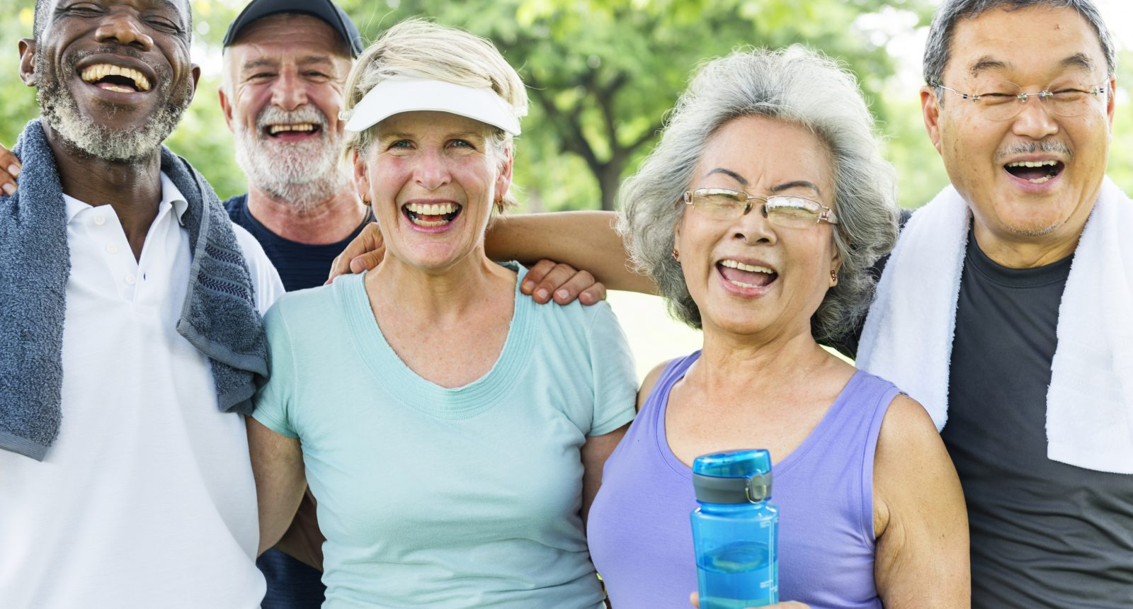 Group of diverse seniors smiling and laughing after exercise