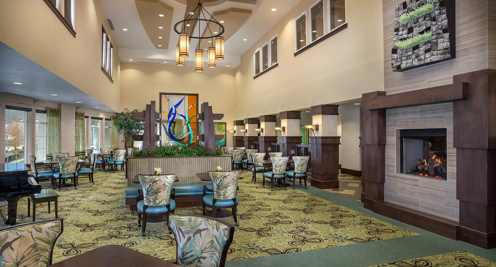 Senior housing community interior with vaulted ceilings and seating for guests and residents