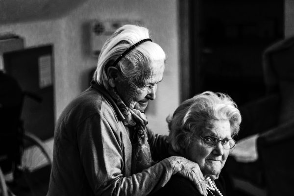 Two elderly women in black and white