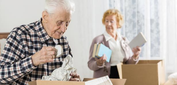 Senior man and woman packing and downsizng