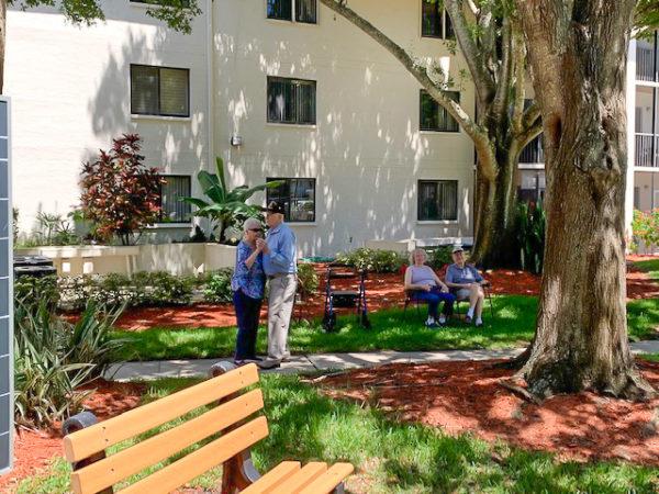 Senior couples i the outdoor Buena Vida courtyard