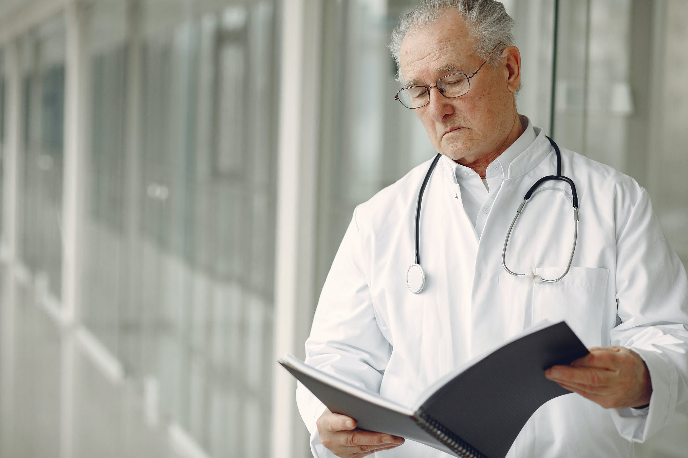 Male medical doctor reviewing a file