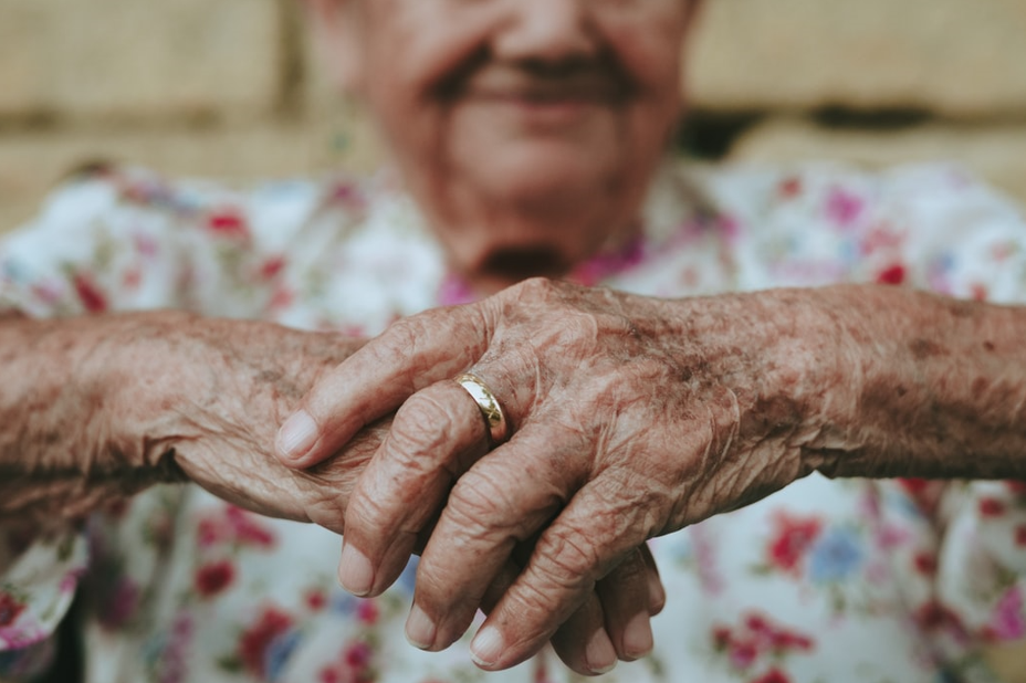 Elderly woman with her hands folded in front