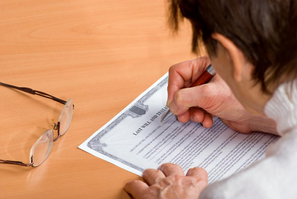 Senior woman writing a will